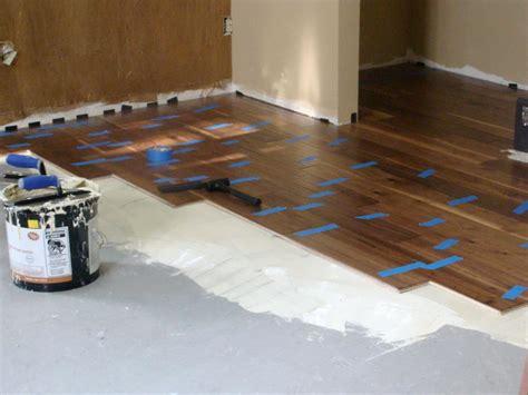 installing wooden floors on concrete installing hardwood flooring over concrete howtos diy pallet wood for flooring over concrete