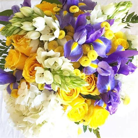 Yellow and purple wedding bouquet with roses iris snap