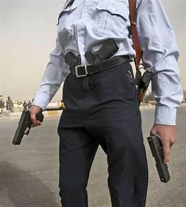 People holding guns seem taller, more muscular ...
