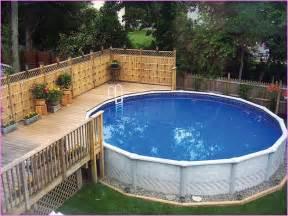 landscaping around above ground pool back yard pool