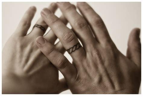 10th anniversary poked wedding ring tattoos tat2s