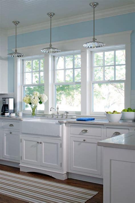 glass pendant lighting white farm sink kitchen windows