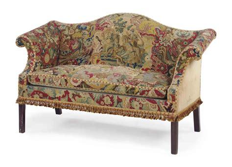 Camelback Settee by An Needlepoint Upholstered Mahogany Camelback