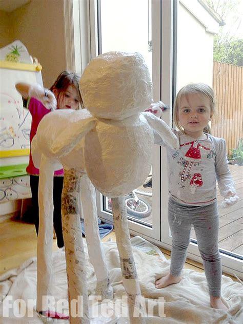 papier mache sculptures shaun  sheep