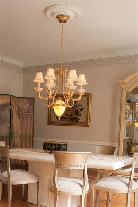 how to fit a chandelier how to install a chandelier the money pit