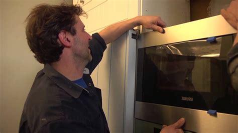 fixation meuble cuisine haut installer des électroménagers encastrables hotte micro