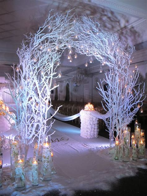 stunning winter themed ceremony arch candle accents amaryllis event decor northvale