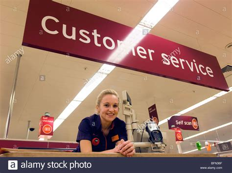 help desk customer service sainsbury 39 s supermarket in uniform at a customer