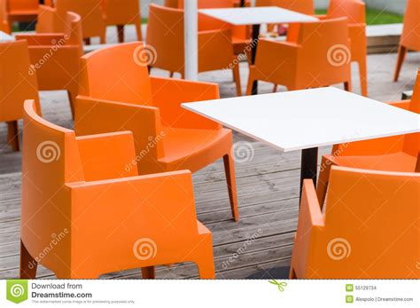 modern furniture outdoor cafe terrace with orange chairs