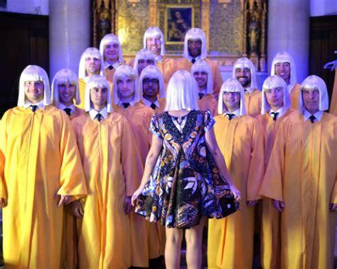 sia sings chandelier accompanied by a choir