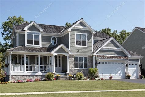 wrap around porch home plans suburban home with wraparound porch stock photo lmphot