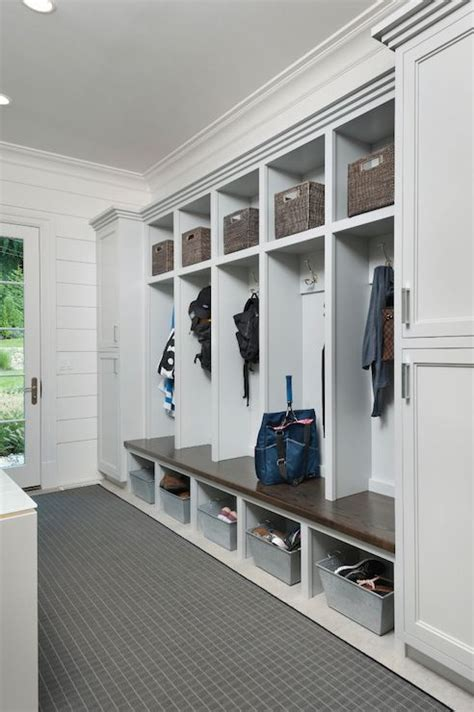 long mudroom features closed cabinets flanking open