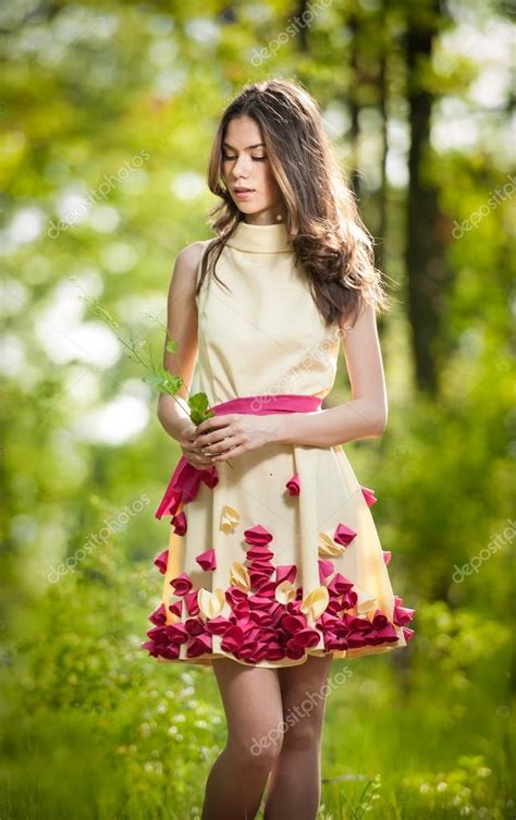 Beautiful Model And Dressed Beautiful In A Yellow Dress In The Woods