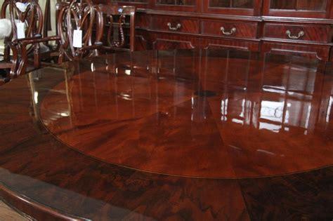 mahogany pedestal dining table  burled walnut