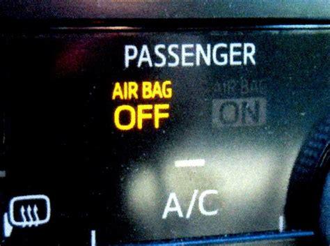 passenger airbag light touchy airbag light automotive service professional