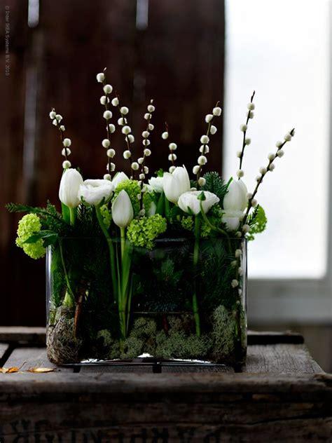 white flower table l flower arrangement in rectangle vase with green viburnum