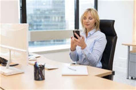 mature female executive  smartphone  office stock