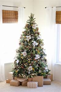 Christmas trees are decorated with flowers instead of for Christmas tree decorations with flowers
