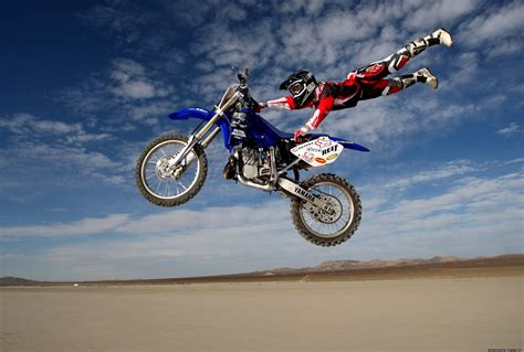 motocross bike pictures motocross flying rider hd wallpaper widescreen wallpaper