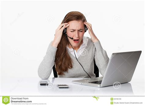 Desperate 20s Working Woman Under Shock With Headset And Computer Stock Photo - Image: 63105723