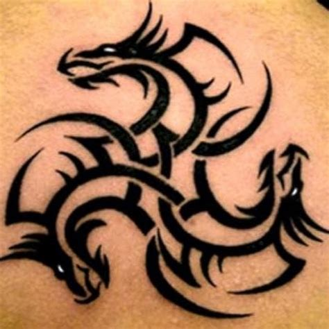 Awesome Tribal Dragon Tattoo On Leg