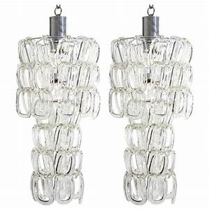 Matching pair of angelo mangiarotti glass chandeliers at