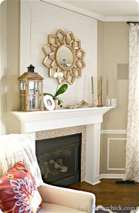 wood plank wall fireplace starburst mirror thrifty decor
