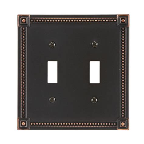 amerelle leaf 2 toggle wall plate aged amerelle leaf 2 toggle wall plate aged bronze 85ttvb
