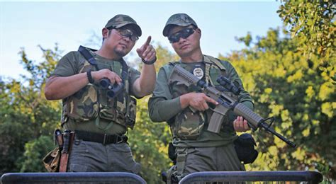 wang    zhang guangrui   armed patrol    pools national park  zimbabwe