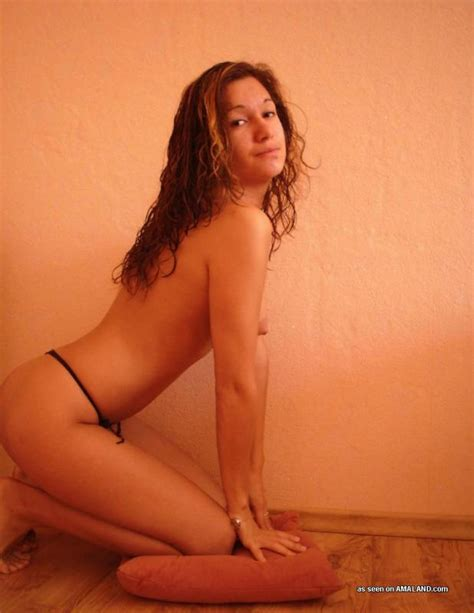 Latina girlfriend posing topless for her BF