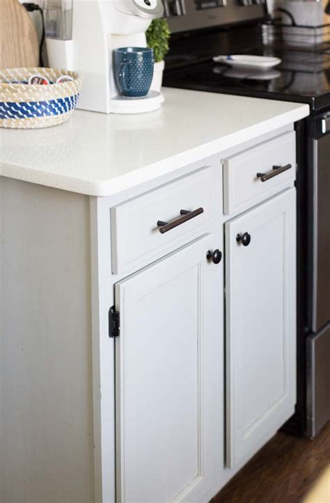 changing kitchen cabinet hardware mixing metals kitchen hardware update home base 5228