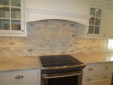 marble subway tile kitchen backsplash with feature time
