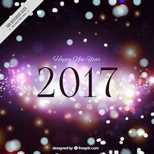 Happy new year background with bokeh effect Vector | Free ...