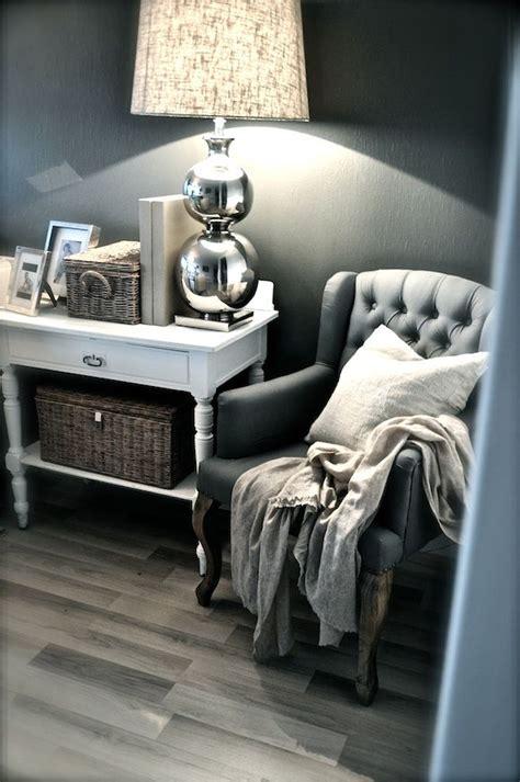 grey wall white furniture baskets  silver lamp