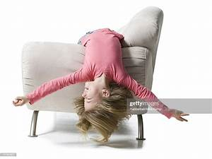 Girl, Lying, Upside, Down, On, A, Couch, High