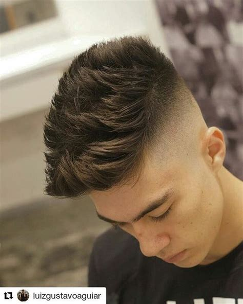 high skin fade  lots  spiky texture  length  top ideal summer cut hairstyles