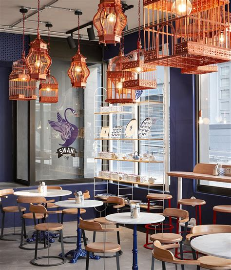 Very good book about design of cafes, this one has very good quality and has a good variety of designs. The worlds top coffee shops for design lovers | Wallpaper*