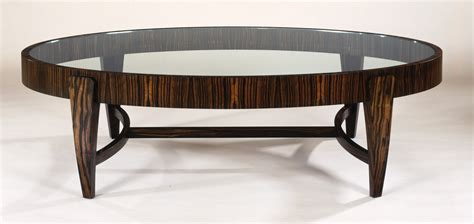 Oval Glass Top Coffee Table With Wooden Legs And Laminate