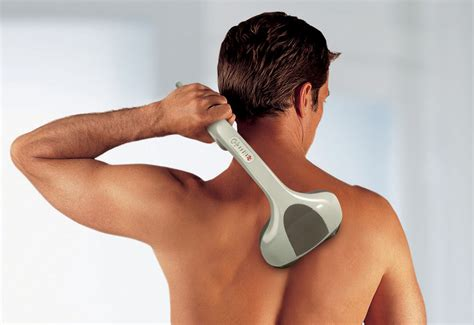 Percussion Action Handheld Massager @ Sharper Image
