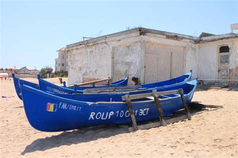 wooden boat   beach  public domain
