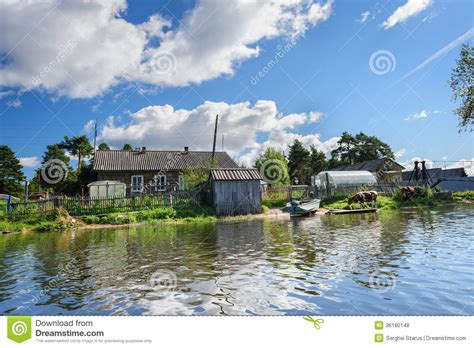 russian wooden houses  river bank stock photo image