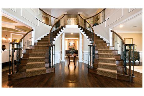 Foyer Meaning by A Pair Of Sweeping Staircases Define The Stunning