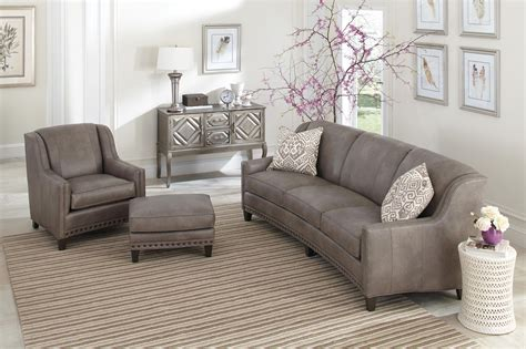 slightly curved sofa with sloping track arms and nail