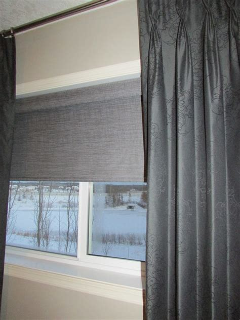 stationary pinch pleat drapes operable roller shade