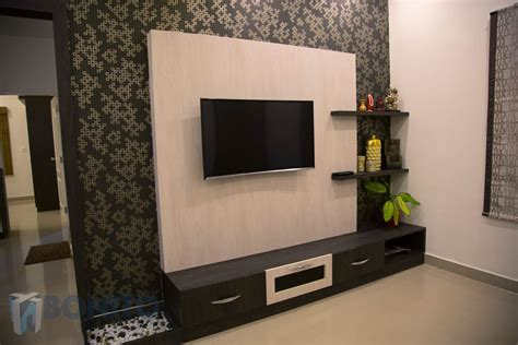 Asian living room photos: tv unit design with wallpaper