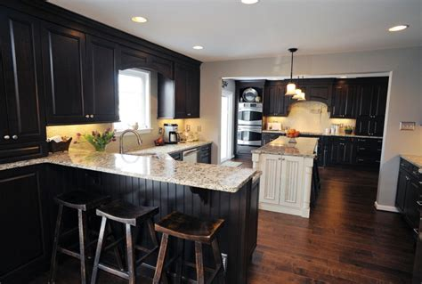black kitchen cabinets with dark wood floors 3373 home