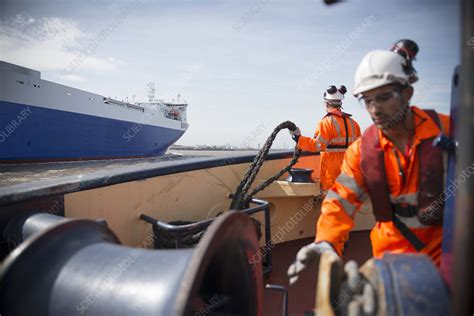 Tug Boat Price In India by Workers On Tug Boat Reeling In Rope Stock Image F006
