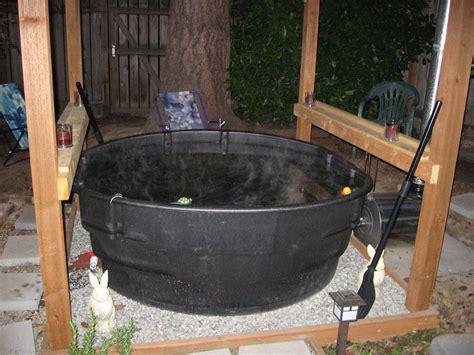 wood fired stock tank hot tub alternative energy