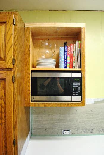 hide  microwave building    vented cabinet