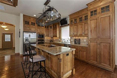 which flooring is best for kitchen 25 best ideas about hickory kitchen cabinets on 2037
